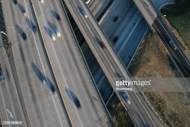 Vehicles travel along the I-405/I-110 freeway interchange in Gardena, California, U.S., on Friday, May 28, 2021. The days of bargain basement...