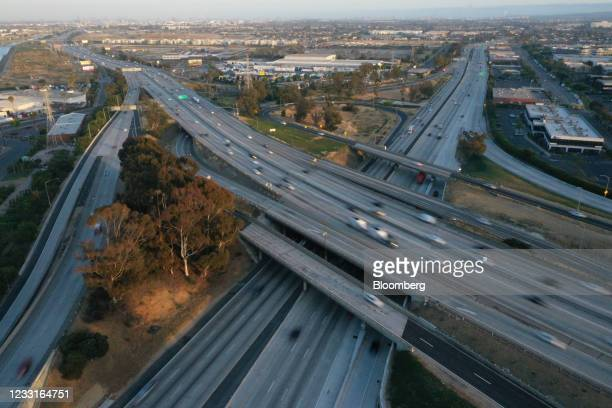 Vehicles travel along the Interstate 405 and Interstate 110 freeways in Gardena, California, U.S., on Friday, May 28, 2021. The days of bargain...