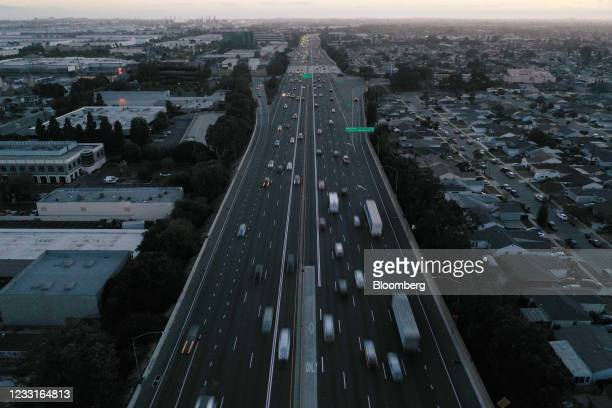 Vehicles travel along the Interstate 405 freeway in Gardena, California, U.S., on Friday, May 28, 2021. The days of bargain basement airfares are...