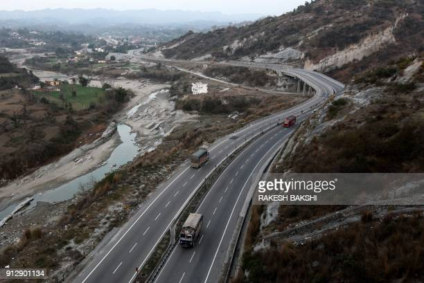 Vehicles travel on the JammuSrinagar highway in Jammu on Feburary 1 2018 India in its annual budget February 1 expanded its infrastructure spending /...