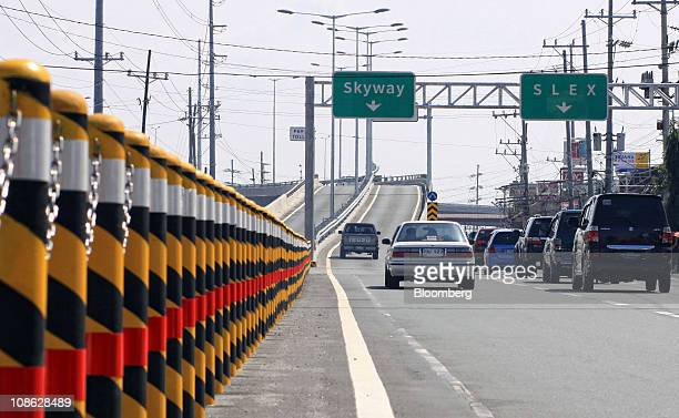 Vehicles travel on the newly constructed Skyway extension of the South Luzon Expressway in Manila, the Philippines, on Sunday, Jan. 30, 2011. The...