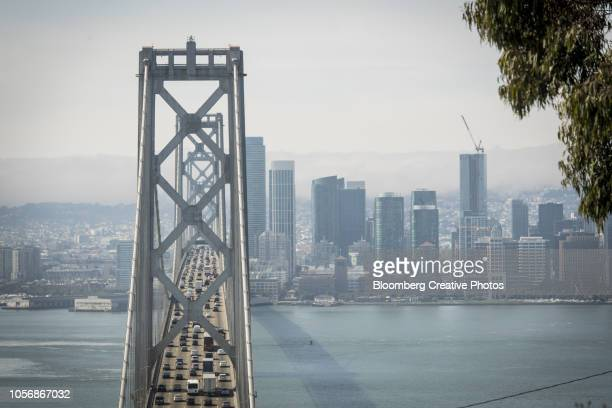 vehicles travel on the oakland-san francisco bay bridge in san francisco - bay bridge stock pictures, royalty-free photos & images