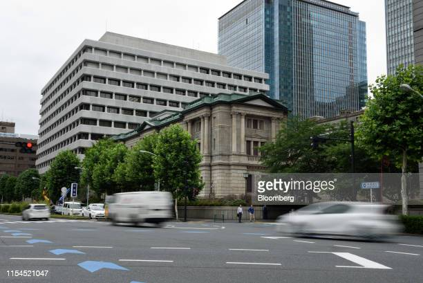 Vehicles travel past the Bank of Japan headquarters in Tokyo, Japan, on Monday, July 8, 2019. Governor Haruhiko Kurodasaid extremely low interest...