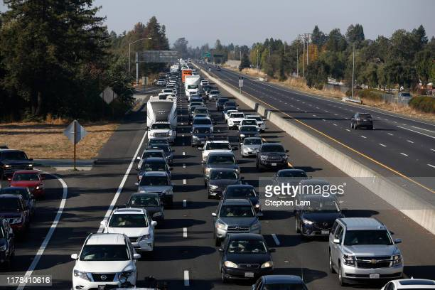 Vehicles travel South along Highway 101 as residents evacuate towns and cities in anticipation of the expected wind event on October 26 2019 in...