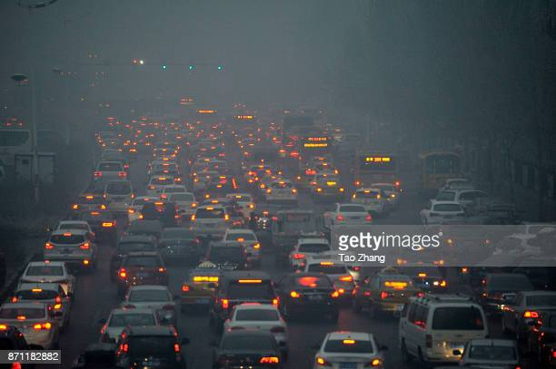 Vehicles travel through a main thoroughfare during severe air pollution on November 7 2017 in Harbin China Meteorological authorities in the province...