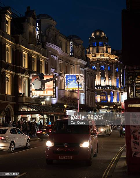 Vehicles travelling down Shaftesbury Avenue London in front of an illuminated Lyric Theatre at night on September 29 2016 in London EnglandTaking...