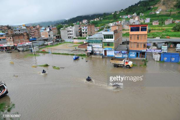 Vehicles travelling through water logged road at Banepa Kavrepalanchok Nepal on Friday July 12 2019 Due to the poor water drainage management system...
