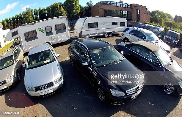 Vehicles under seals Mercedes and Audi cars a campingcar and a caravan are parked and secured by French gendarmes on September 29 2012 in...