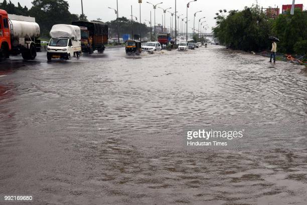 Vehicles wade through on water logging road at Kalmboli on July 4 2018 in Mumbai India Heavy rains made a comeback in Mumbai causing waterlogging in...