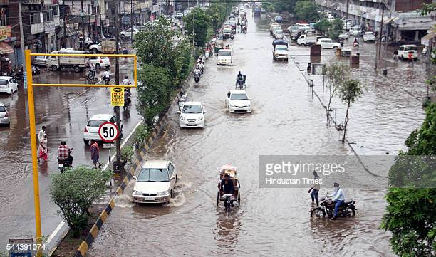 Vehicles wade through the flooded water after heavy rains at Khalsa Mohala Road on July 2 2016 in Patiala India The sudden rain on Saturday morning...