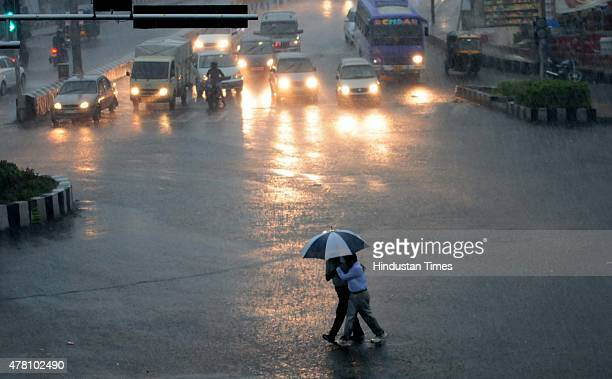 Vehicles wade through water logged road at Jyoti Talkies Road after a heavy rainfall on June 22 in Bhopal India In first heavy shower of this season...
