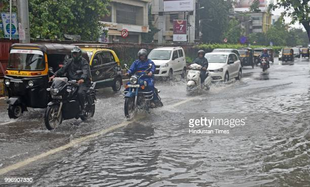 Vehicles wade through waterlogged street at SV Road Santacruz on July 11 2018 in Mumbai India Heavy rains made a comeback in Mumbai causing...