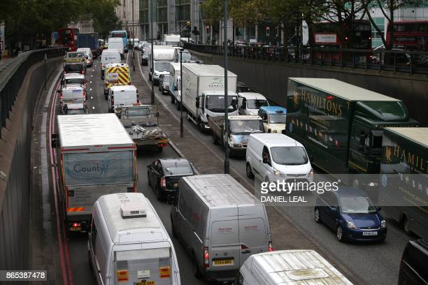Vehicles wait in a traffic jam in central London England on October 23 2017 Drivers of the most polluting vehicles will face an extra daily charge...