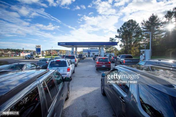 Vehicles wait in line at a gas station on Route 1 in Falmouth in the late afternoon on Monday Oct 30 2017