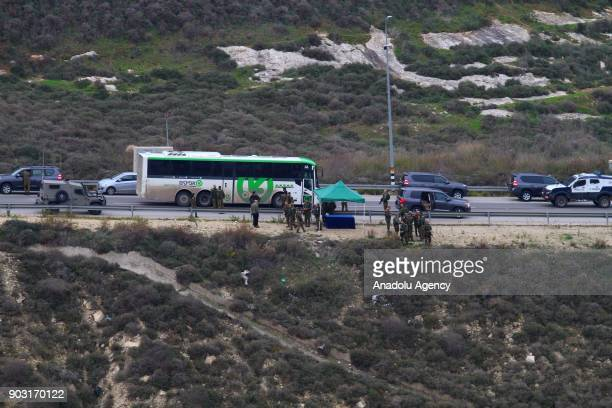 Vehicles wait in line to pass through an Israeli checkpoint after a Jewish settler killed at Havat Gilad Jewish settlement neighborhood in Nablus...