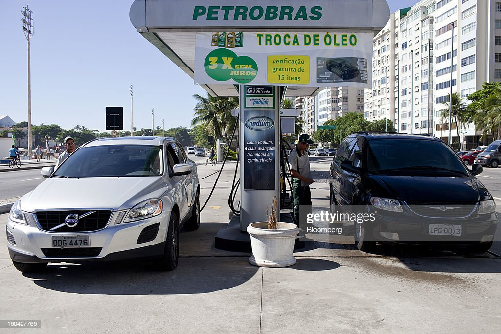 Vehicles wait to be filled with gas at a Petroleo Brasileiro SA (Petrobras) station in Rio de Janeiro, Brazil, on Thursday, Jan. 31, 2013. State-controlled oil company Petrobras announced earlier this week that it would raise gasoline and diesel prices by 6.6 percent and 5.4 percent, respectively. Photographer: Dado Galdieri/Bloomberg via Getty Images