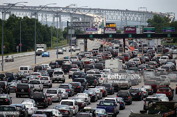 Vehicles wait to cross the Chesapeake Bay Bridge on US Routes 50 and 301 July 3 2013 near Sandy Point State Park in Arnold Maryland The Chesapeake...