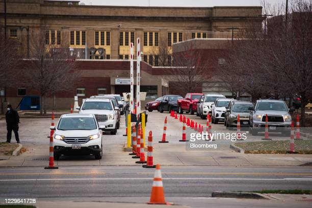 Vehicles wait to enter a drive-thru Covid-19 testing facility at The Cleveland Clinic in Cleveland, Ohio, U.S., on Saturday, Nov. 14, 2020. On...
