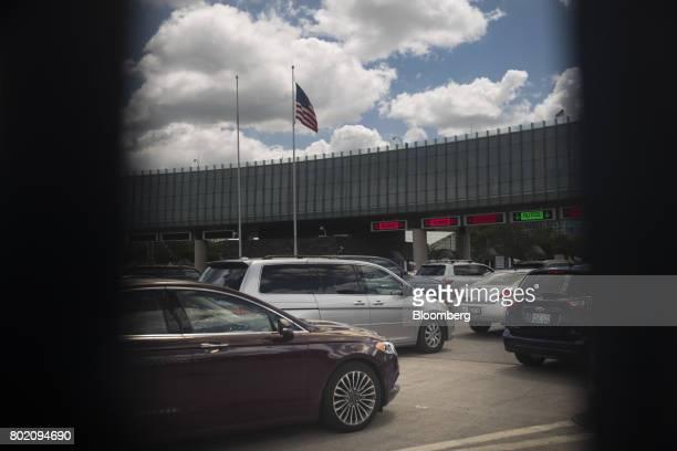 Vehicles wait to enter Canada at the Niagara Falls International Rainbow Bridge in Niagara Falls New York US on Wednesday June 21 2017 The 150th...