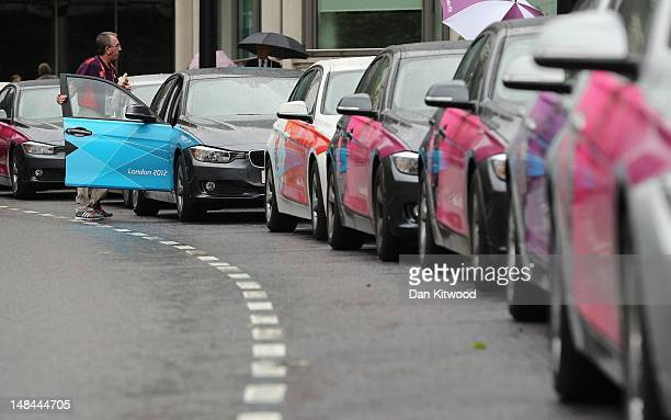 LOCOG vehicles wait to transport officials and dignitaries from Park Lane to the Olympic site on July 16 2012 in central London England The first...