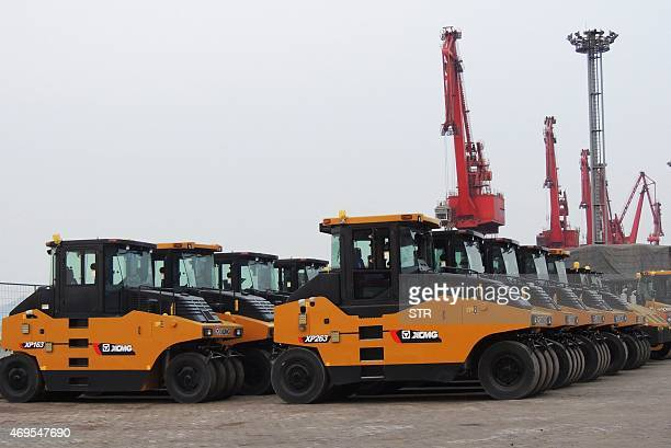 Vehicles waiting to be exported are parked on Lianyungang port in Lianyungang east China's Jiangsu province on April 13 2015 China's GDP growth...
