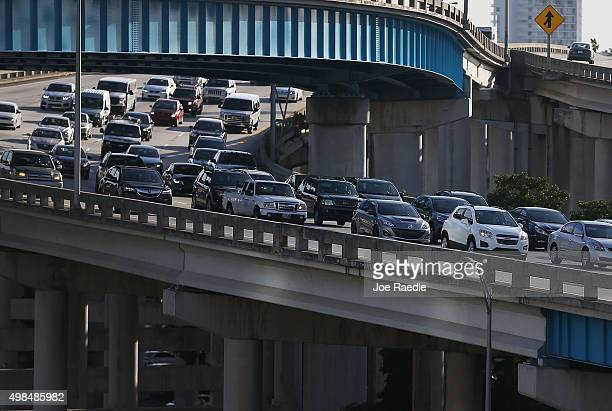 Vehiclespass on I95 as travelers prepare for the upcoming Thanksgiving Day holiday on November 23 2015 in Miami Florida AAA announced in their travel...