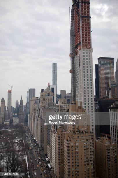 Vehicular traffic moves along Central Park South near Columbus Circle February 15, 2017 in New York City. Construction of high rise apartment...