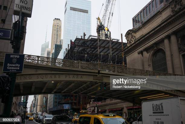 Vehicular traffic moves below construction at the One Vanderbilt skyscraper highrise office building next to Pershing Square and Grand Central...