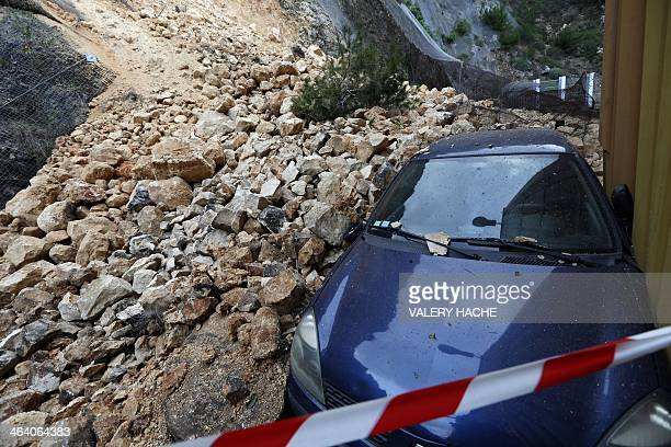 A vehicule is buried after a rockslide on January 20 2014 in Nice southeastern France Many roads were cut in the AlpesMaritimes due to landslides...