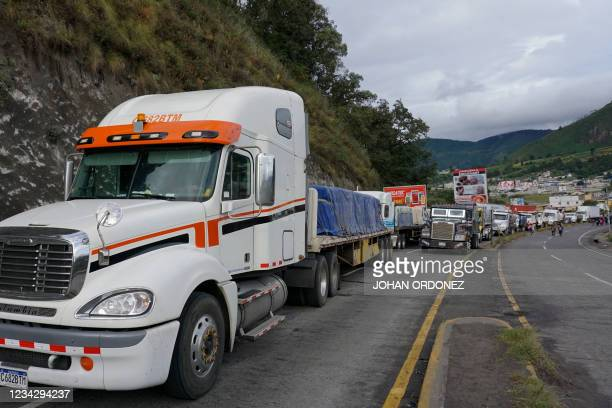 Vehicules remain stop due to a roadblock carried out by indigenous people demanding the resignation of Guatemalan President Alejandro Giammattei and...