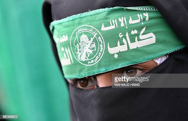 A veild supporter of Hamas joins around 2000 fellow women in a protest on June 6 2009 in Gaza City against West Bankbased Palestinian president...
