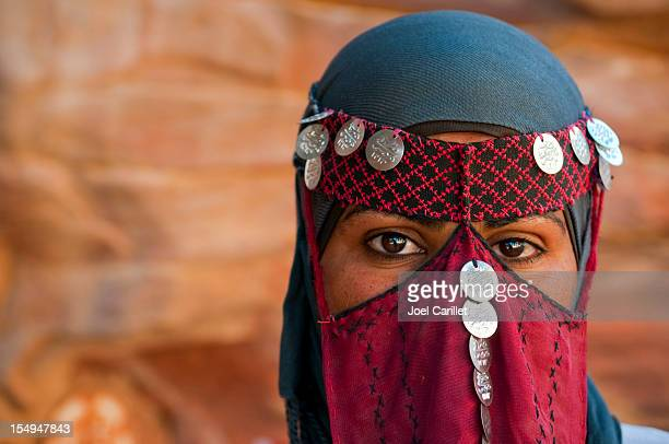 veiled bedouin woman in jordan - jordan middle east stock pictures, royalty-free photos & images