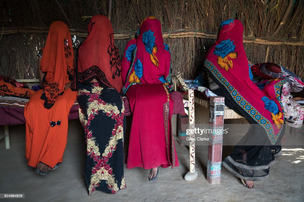Veiled displaced women at home in Abs, North Yemen.