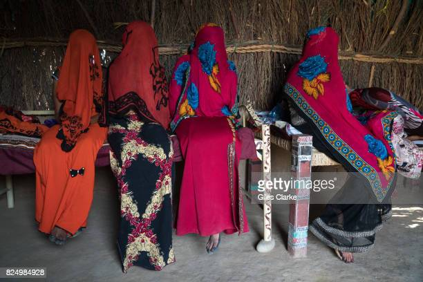 Veiled displaced women at home in Abs North Yemen