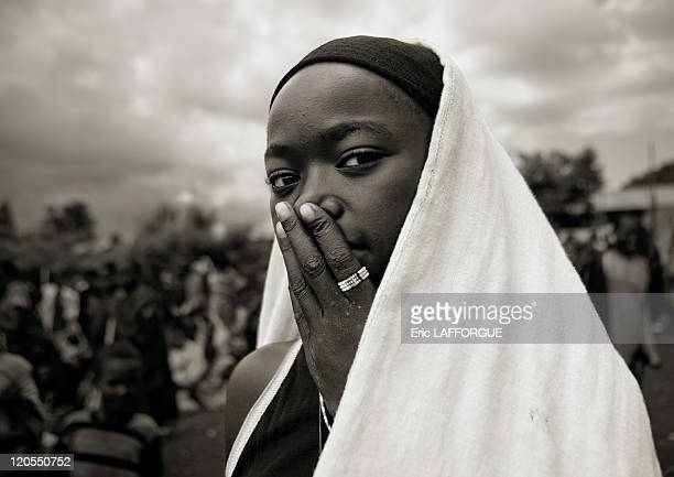 Veiled Dizi girl with the hand on her mouth in Tum market Omo valley Ethiopia on July 03 2010 Tum market Dizi people are an ethnic group from...