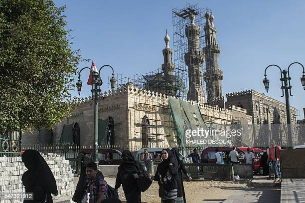 Veiled Egyptian women walk near alAzhar mosque in Cairo on July 14 2016 Many believed that Mohamed Morsi's ouster amid mass protests and replacement...