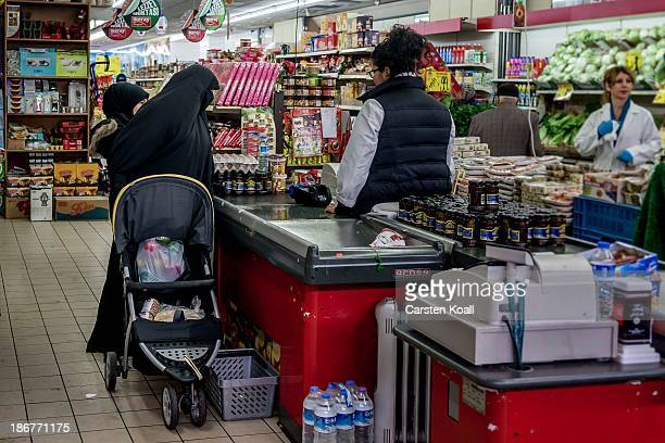 A veiled Muslim woman stands at the checkout in the Turkish supermarket Marketler at KarlMarxStrasse in Neukoelln district on November 02 2013 in...