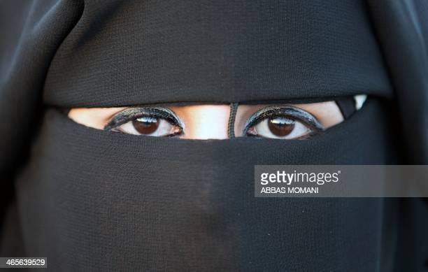 Veiled Palestinian bride is pictured on January 28 during a mass wedding ceremony in the West bank city of Jericho. Nearly 600 Palestinians were...