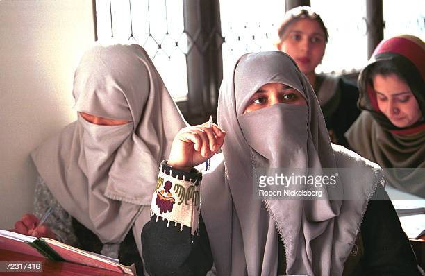 Veiled students listen to a lecture February 16 2000 at Fatima Women's University a new university for women in Rawalpindi Pakistan