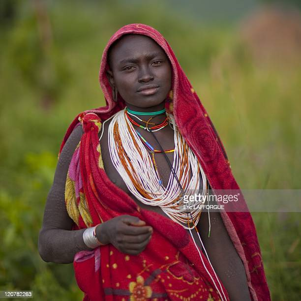 Veiled Suri girl in Turgit village Omo valley Ethiopia on July 05 2010 Surma or Suri are sedentary pastoral people living in south west of Ethiopia...