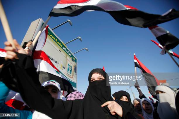 A veiled Syrian expat shouts antiPresident Bashar alAssad slogans during a protest in solidarity with antigovernment protesters in Syria outside the...