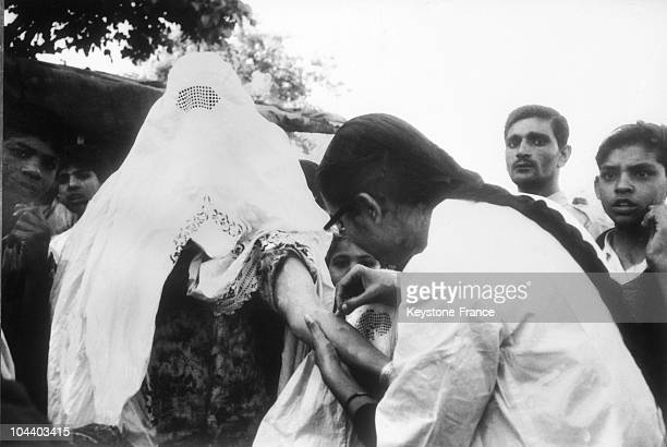 A veiled woman getting vaccinated during a serious smallpox epidemic in Pakistan in 1961 The purdah law was violated in order to halt the spread of...