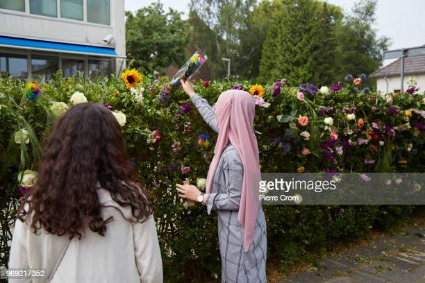 A veiled woman places flowers outside the Laleli Mosque on June 7 2018 in Rotterdam NetherlandsThe antiIslam group Pegida plans to roast pigs on a...