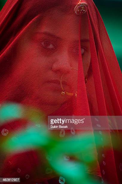 Veiled woman with traditional ornaments