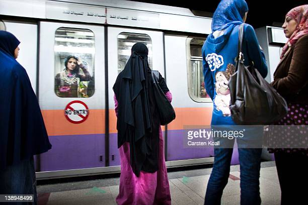 Veiled women wait for a train platform in the subway station on February 14 2012 in Cairo Egypt In times of revolution Egypt's tourism has lost 30...