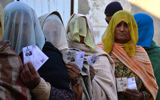 Veiled women wait in a queue to cast their votes in polling booth in Badal village on January 30 2012 in Lambi India Assembly polls of all 117 seats..
