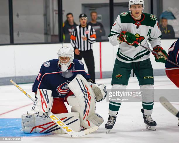 Veini Vehvilainen of the Columbus Blue Jackets follows the play next to Nico Sturm of the Minnesota Wild during Day2 of the NHL Prospects Tournament...