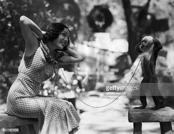 Velez Lupe Actress Mexiko* with the picture monkey Josephine between scenes in The Cuban Love Song Photographer Gregor Kutschuk Published by 'Tempo'...