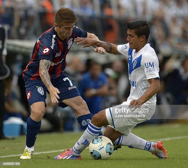 Velez Sarsfield's midfielder Lucas Romero vies for the ball with San Lorenzo's midfielder Julio Buffarini during the Argentina's first division...