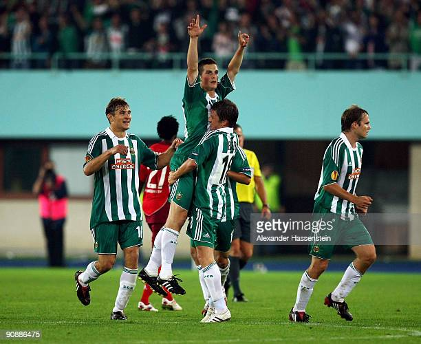 Veli Kavlak of Vienna celebrates scoring his team's third team goal with his team mate Hannes Eder during the Europa League match between SK Rapid...